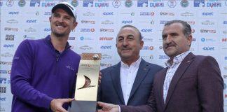 Turkish Foreign Minister Mevlut Cavusoglu (C), Turkish Youth & Sports Minister Osman Askin Bak (R) and Justin Rose (L) of England